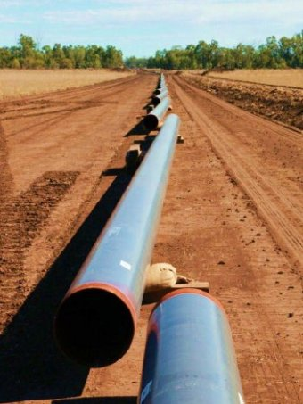 Pipes laid out during the construction phase of a pipeline.