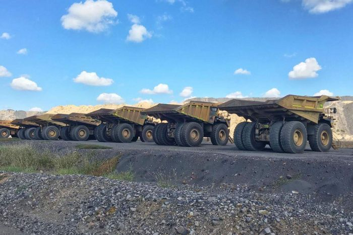 Mining trucks at a coal operation in central Queensland.
