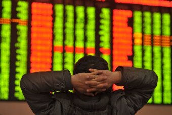 An investor looks at the bourses.