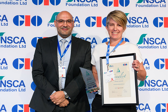 Photo of Pearson Australia receiving their award from Safe Work Australia Director, Frank Cachia.