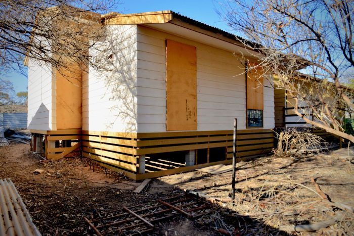 A boarded-up house in Leigh Creek