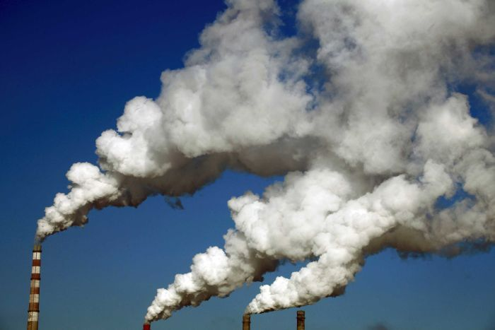 Smoke billows from the chimneys of a heating plant in the Chinese city of Jilin.