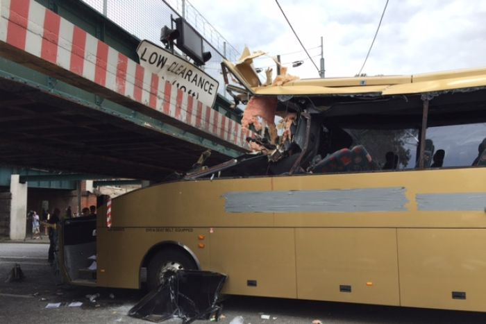 The wreckage of the bus, wedged under the bridge.