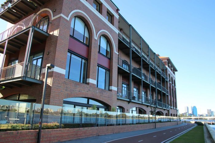 An angled wide shot of the Old Swan Brewery brick building in Perth from the Swan River side.