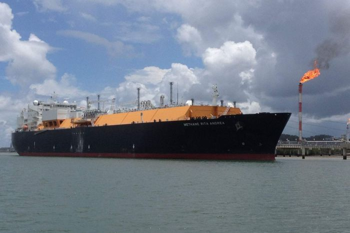 An LNG ship docked at a port.