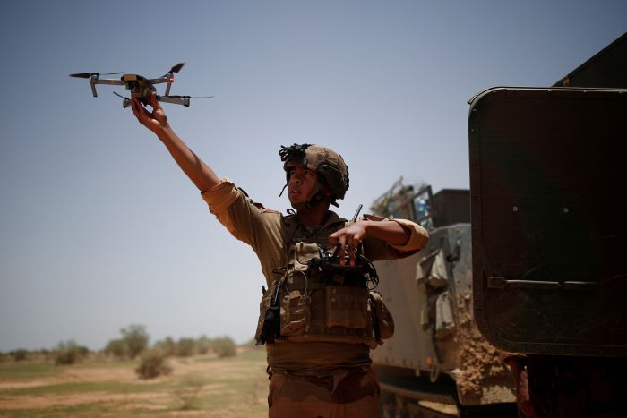 A soldier releases a drone.