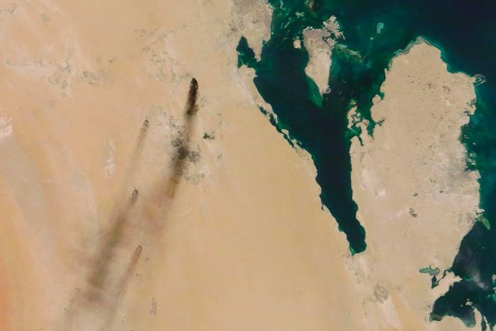 A satellite photo of dark plumes of smoke stretching across the north-eastern Saudi Arabian countryside.