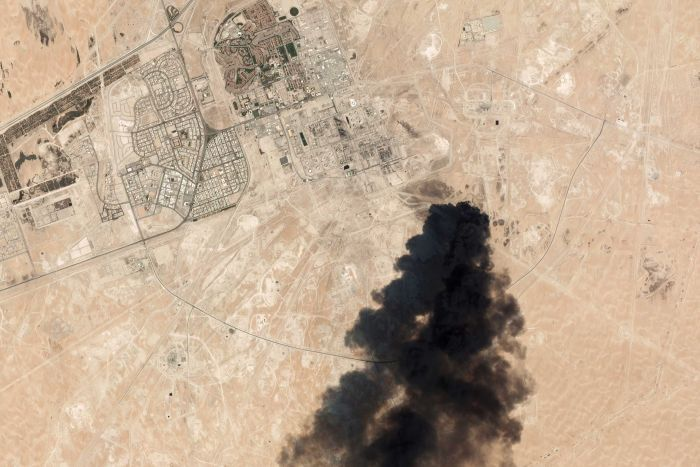 satellite image of Saudi processing oil plant showing a huge black smoke cloud